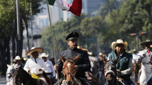 People ride on horses during a march in support of the 43 missing students of the Ayotzinapa Teacher Training College Raul Isidro Burgos, in Mexico City